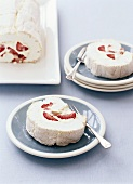 Meringue and cream roulade with strawberries
