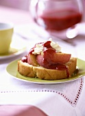 Piece of Madeira cake with nectarines & strawberry sauce