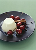Panna cotta con le ciliege (Cream dessert with cherries, Italy)