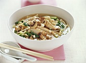 Asian noodle soup with chicken and mushrooms