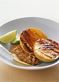 Grilled mango slices with coconut rice