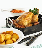 Roast chicken with potatoes and sausages
