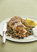 Roast chicken breast fillet on lentil salad