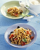Tagliatelle with tomato pesto, tomatoes and olives