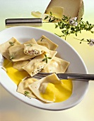 Ravioli with spicy ricotta and pepper filling and pepper sauce