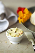 Nasturtium butter in a small bowl