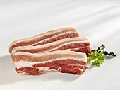 Three slices of raw belly pork