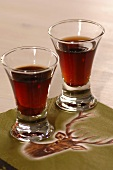 Two glasses of herb liqueur