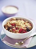 Mixed berries with chopped nuts and honey