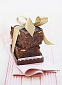 Two pieces of fruit cake, gift-wrapped