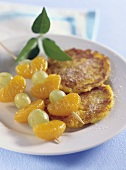 Sweet pumpkin & potato cakes with skewered fruit
