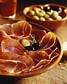 Platter of ham with olives