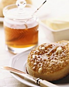Crumpet with honey (yeast cake cooked on griddle, England)