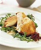 Breaded chicken escalope on salad leaves