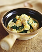 Fish stew with spinach and saffron