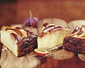 Three pieces of plum and sauerkraut cake