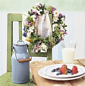 Flower wreath hanging on a chair