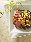 Duck with thousand spice glaze and Asian vegetables