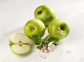 Granny Smith apples, three whole and one half