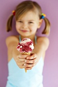 Small girl holding Amarena cherry ice cream