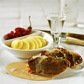 Elk roulades with mashed potato and cranberry chutney