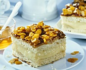 Two pieces of filled bee sting cake (Bienenstich)