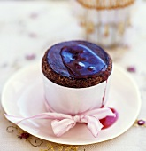 Chocolate soufflé with hot raspberry sauce