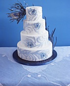 Wedding cake decorated with artificial peacock feathers