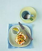 Soft cheese and papaya on wholemeal roll, teacup