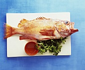 A redfish on a kitchen board