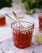 Strawberry and elderflower jam with spoons in jar
