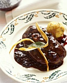 Ossobucco of lamb with elderberry sauce and dumpling