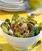 Salad leaves with beans and quail legs