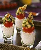 Cocktail tomatoes stuffed with smoked salmon and caviar