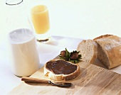 Chocolate spread and bread, milk and orange juice