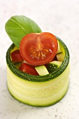 Courgette roll with tomato and pepper