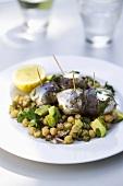 Marinated sardine rolls on chick-pea salad