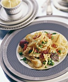 Tagliatelle with vegetables and strips of bacon