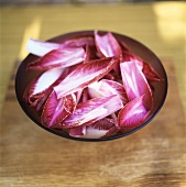 Red chicory leaves in a bowl