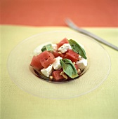 Pieces of watermelon with sheep's cheese and pine nuts