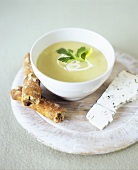 Celeriac cream soup with blue cheese and savoury stick