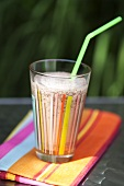 Chocolate shake in glass with straw