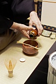 Tea master at tea ceremony, matcha tea powder