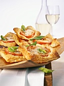 Puff pastry slices with tomato and basil