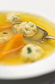 Chicken soup with kneidlach (matzo dumplings)
