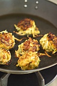 Onion bhajis (fried onion cakes, India)