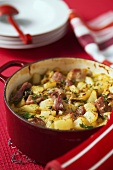 Potato and savoy stew with sausages and bacon