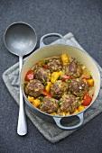 Meatballs in pumpkin and pepper stew