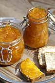 Apricot jam and piece of bread and jam
