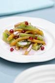 Fruit salad with pomegranate, Sharon fruit and kiwi fruit
